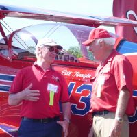Bob Pooler with Pitts S-2C pilot Bill Finagin discussing an aerobatic manoeuvre.