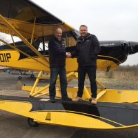 Angus takes delivery of his new Husky A-1C-180 on amphibious floats.